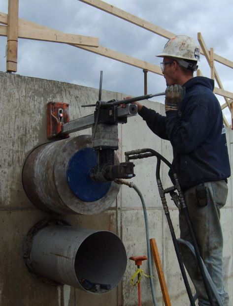 concrete core drilling into cement to fit a large pipe through