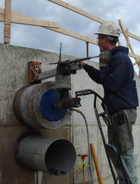 concrete-core-drilling-into-cement-to-fit-a-large-pipe-through1